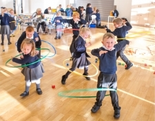 Pupils using hulahoops at Willow Tree Primary School