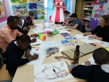 Children working on Rainbow Flag images at Willow Tree Primary