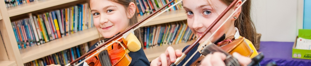 Pupils playing violin at Willow Tree Primary School