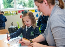 Staff member and a pupil in a lesson at Willow Tree Primary School