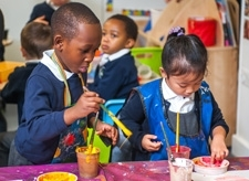 Pupils painting at Willow Tree Primary School