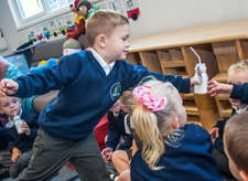 Pupils drinking milk at Willow Tree Primary School