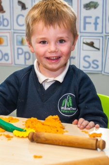 A pupil doing arts and crafts at Willow Tree Primary School