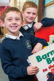 Pupils choosing reading books at Willow Tree Primary School