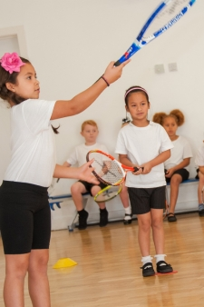 Pupils playing tennis at Willow Tree Primary School